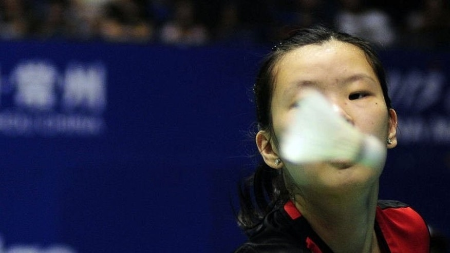 Li Xuerui of China returns a shot against Gu Juan of Singapore during the women's singles event of the 2013 China Masters in Changzhou on September 13, 2013.