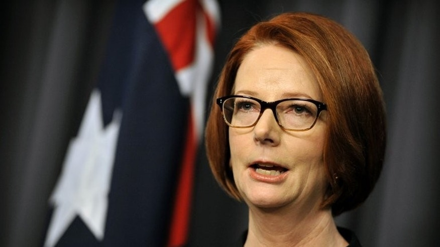 Ousted prime minister Julia Gillard speaks to the media after her defeat in a party room vote to Kevin Rudd at Parliament House in Canberra on June 26, 2013.