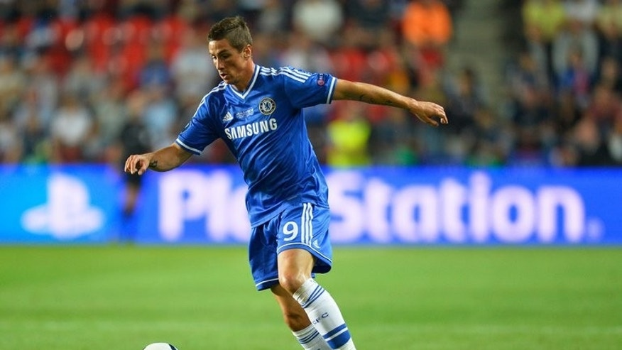 Fernando Torres is on the ball for Chelsea against Bayern Munich at the Eden Stadium, in Prague on August 30. Samuel Eto'o will join Torres and Demba Ba in a three-way battle for the central striker role in Jose Mourinho's Chelsea team.