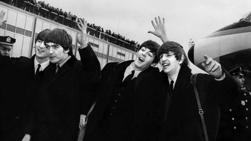 The Beatles -- from left to right, John Lennon, Ringo Starr, Paul McCartney and George Harrison -- arrive at John F. Kennedy Airport in New York on February 7, 1964. A box set of previously unreleased recordings and studio chat by The Beatles including early hits and cover versions is to be released later this year, their record company said Friday.