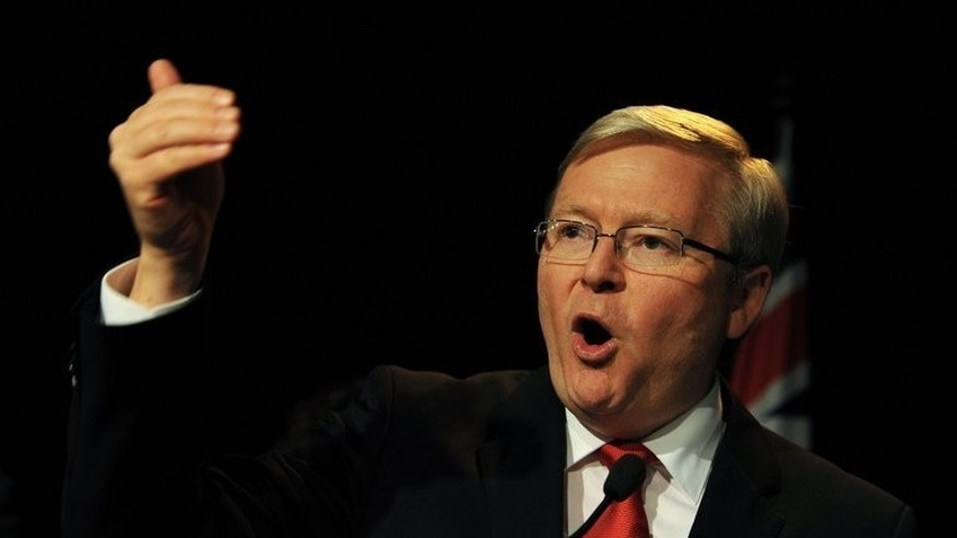 Labor's Kevin Rudd gestures as he concedes defeat while speaking at a Labor party function in Brisbane on September 7, 2013. Counting of postal votes from Saturday's national polls, which saw Rudd displaced as prime minister, is still ongoing.