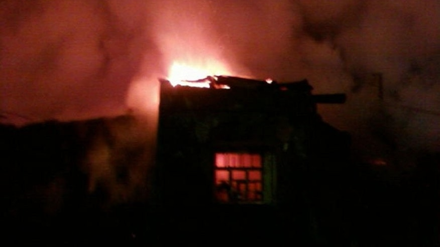 Flames rise from a burning psychiatric hospital in the village of Luka in northwestern Russia, September 13, 2013. A fire at a psychiatric hospital in northwest Russia overnight Thursday left one person dead and 35 others unaccounted for, authorities said.