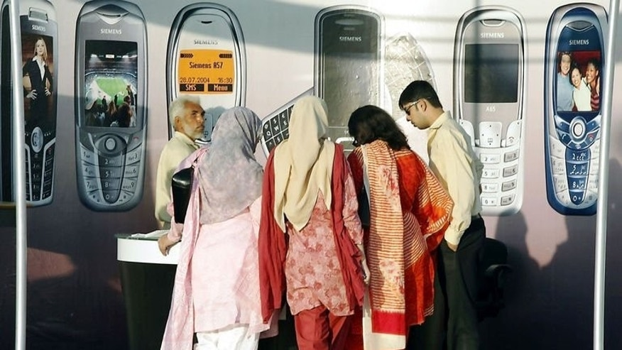 Women visit a stall a mobile phone exhibition in Islamabad in 2005. In a country, where parents keep young people on a tight leash and dating is considered inappropriate, late-night chatting over the phone or Internet can be a way to find love below the radar.