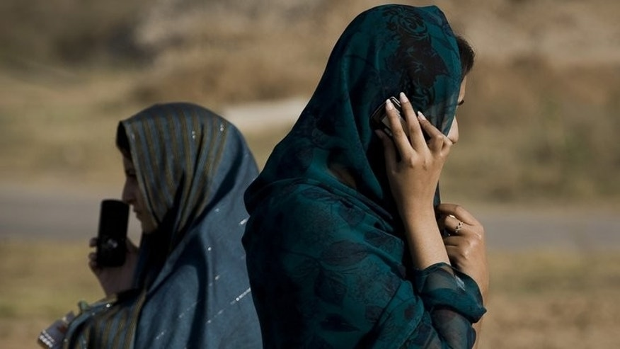 Students speak on mobile phones at Islamic International University in Islamabad. In Pakistan girls can be beaten or even killed by male relatives if there is any hint they are having a relationship and parents like to strictly control the marriages of their offspring.