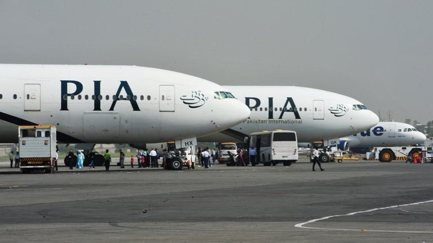 Pakistan International Airline planes at the Benazir Bhutto Airport in Islamabad. Pakistan's new prime minister plans to sell off a 26 percent stake in ailing national carrier PIA and hand over management control in a bid to stem haemorrhaging losses.