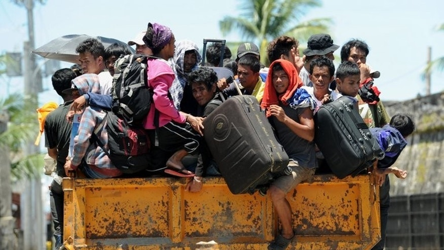 Residents are transported to a safer place during a forced evacuation of villagers near the stand-off between government forces and Muslim rebels in Zamboanga on September 13, 2013.