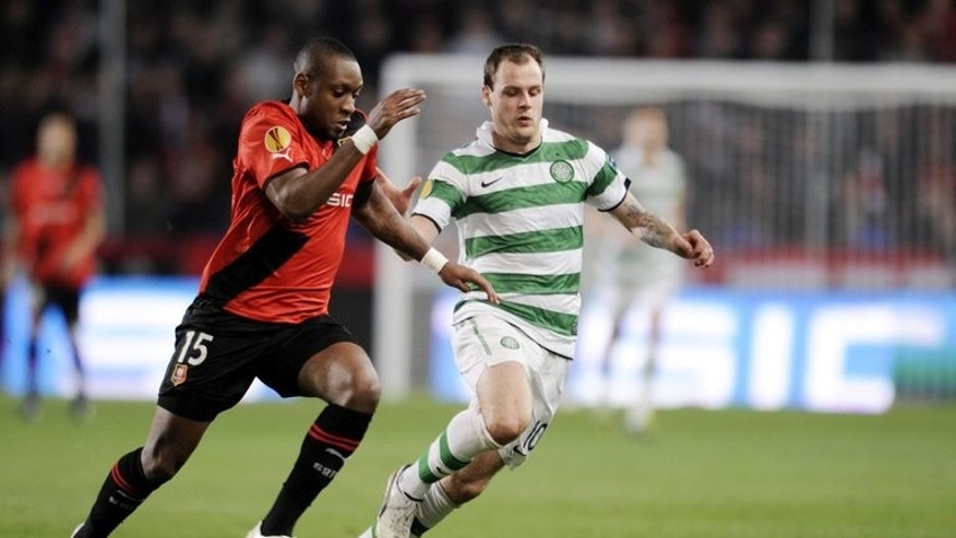 Celtic striker Anthony Stokes (R) and Rennes' Jean Armel Kana Biyik during a Europa League football match in western France on October 20, 2011.