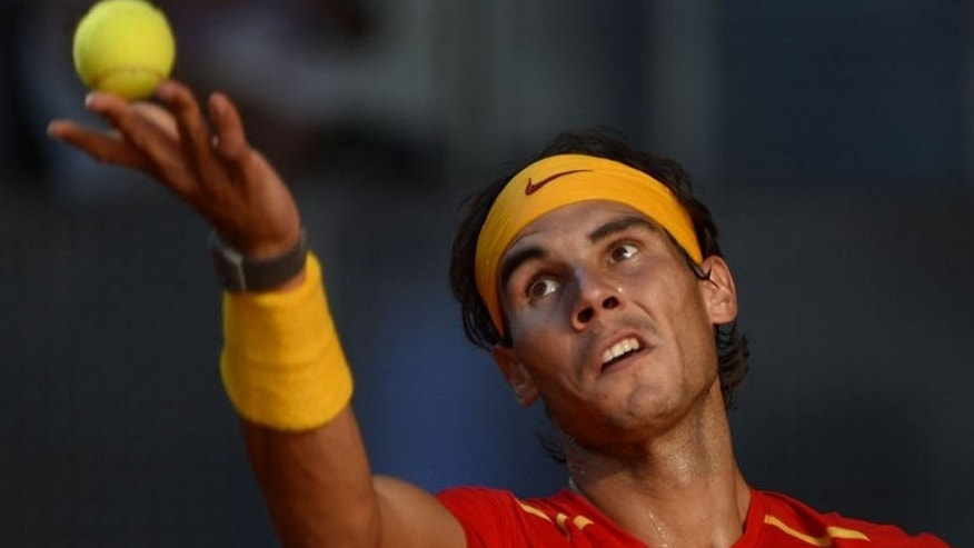 Spain's Rafael Nadal serves to Ukraine's Sergiy Stakhovsky during the World Group Play-offs 2013 at the Caja Magica sports complex in Madrid on September 14, 2013. Winning nations qualify for the World Group in 2014.