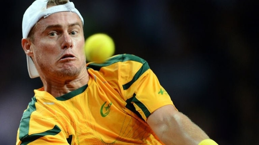 Australia's Lleyton Hewitt returns to ball during the first tennis match of the Davis Cup play-off between Poland and Australia at the Torwar Hall, on September 13, 2013 in Warsaw.