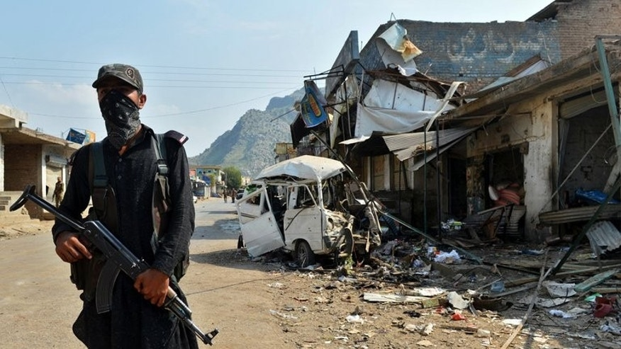 A Pakistani policeman stands guard at the site of a suicide bomb attack in Darra Adam Khel on October 13, 2012. A bomb explosion Saturday killed two members of a Pakistani pro-government militia and wounded four others during an archaeological dig in a tribal district on the Afghanistan border, officials said.