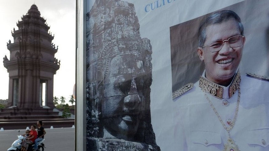 A poster of Cambodian Prime Minister Hun Sen is pictured at a park in Phnom Penh on September 8, 2013.