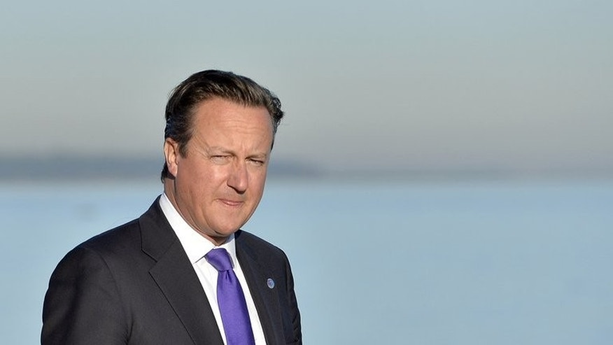 British Prime Minister David Cameron is pictured walking at the G20 site in Saint Petersburg on September 6, 2013.