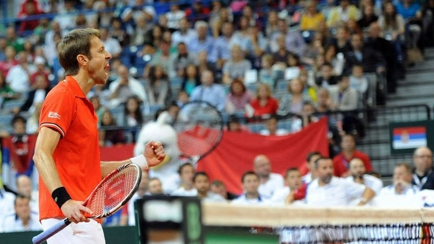 Canada's Daniel Nestor celebrates a victory against Serbia's Nenad Zimonjic and Ilija Bozoljac during a Davis Cup semi-final doubles match between Canada's Daniel Nestor and Vasek Pospisil and Serbia's Nenad Zimonjic and Ilija Bozoljac at the Belgrade Arena on September 14, 2013.