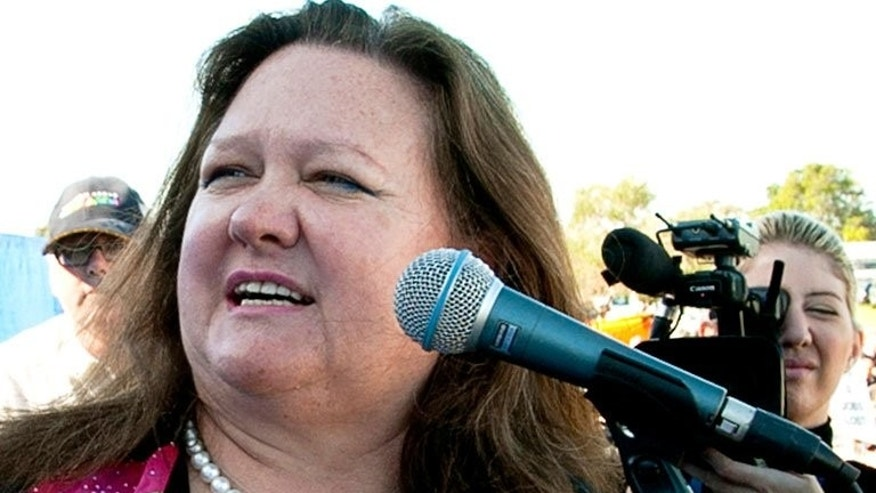 Australia's richest person Gina Rinehart speaks during a rally in Perth on June 9, 2010. The world's richest woman Gina Rinehart is believed to have increased her holding in Australian media group Fairfax to more than 15 percent, reports said on June 15.??AFP PHOTO / Tony ASHBY