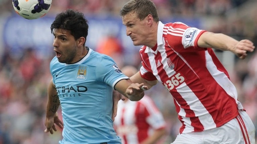 Manchester City's Argentinian striker Sergio Aguero (L) vies with Stoke City's German defender Robert Huth (R) during the English Premier League football match between Stoke City and Manchester City at The Britannia stadium, Stoke-on-Trent, England, on September 14, 2013. The match ended in a 0-0 draw.