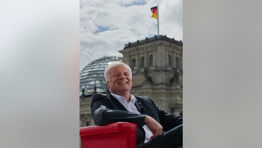 Chairman of the Christian Social Union (CSU) and State Premier of Bavaria, Horst Seehofer, gives an interview to German public broadcaster ARD next to the Reichstag, the building housing the Bundestag, Germany's lower house of parliament in Berlin on August 11, 2013.