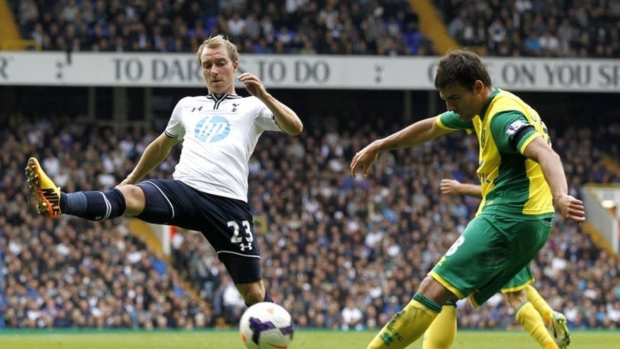 Tottenham Hotspur's Danish midfielder Christian Eriksen (L) vies with Norwich City's Spanish midfielder Javier Garrido during the English Premier League football match between Tottenham Hotspur and Norwich City at White Hart Lane in north London on September 14, 2013. Spurs won 2-0.