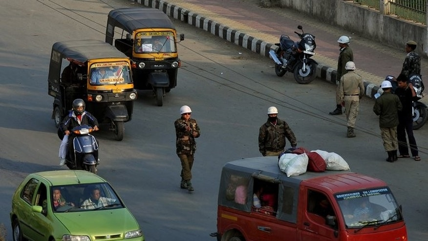 File picture shows a police checkpoint in Imphal in the northeastern Indian state of Manipur. A powerful bomb blast in a busy area on the outskirts of Imphal has killed nine labourers and injured about 21 other people, police said Saturday.