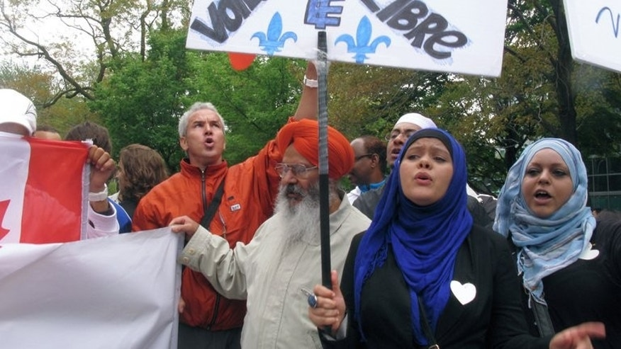 "People demonstrate in Montreal against a Quebec government plan to ban ""conspicuous"" religious symbols in public buildings or worn by public employees on September 14, 2013."