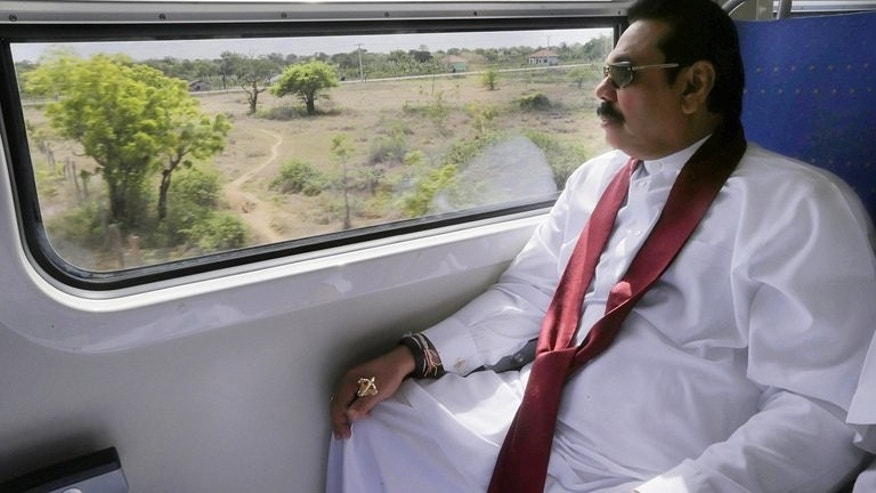 Sri Lankan President Mahinda Rajapakse sits on board a train en route to the former rebel capital of Kilinochchi, on September 14, 2013, in a photo released by the President's Office. A train linking the political home of Sri Lanka's Tamil Tiger rebels with the rest of the island rolled into service on Saturday after a 23-year interruption, officials said.