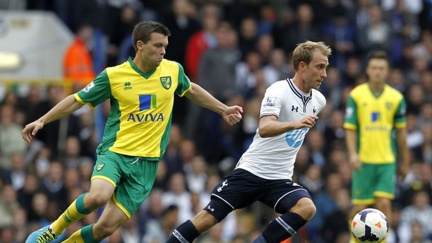 Tottenham Hotspur midfielder Christian Eriksen (R) and Norwich City midfielder Jonathan Howson during their Premier League match at White Hart Lane in north London on September 14, 2013.