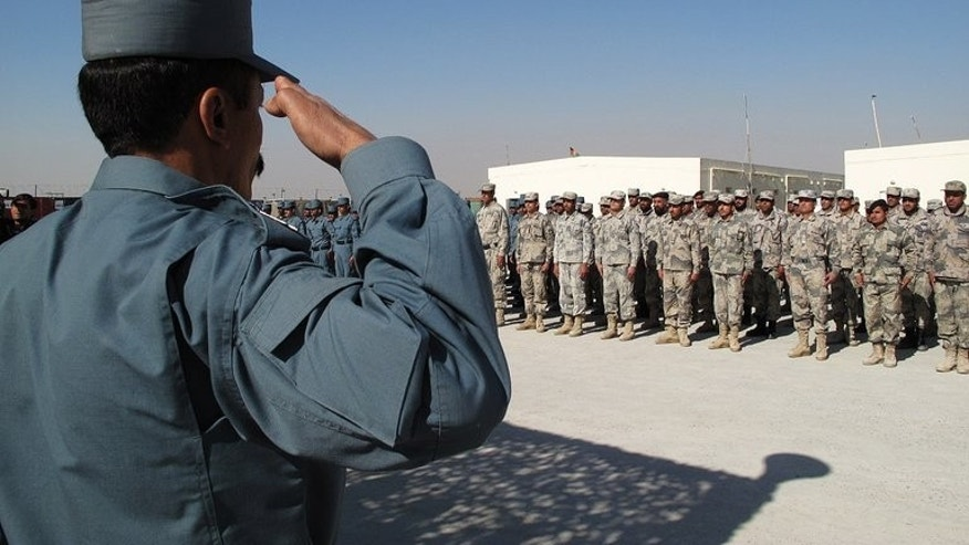 Policemen stand to attention during a graduation ceremony at a police training centre in Helmand province on February 7, 2013. Unknown gunmen shot and seriously injured the top female police officer in Afghanistan's restive Helmand province on Sunday, just months after her high-profile predecessor was killed, officials said.