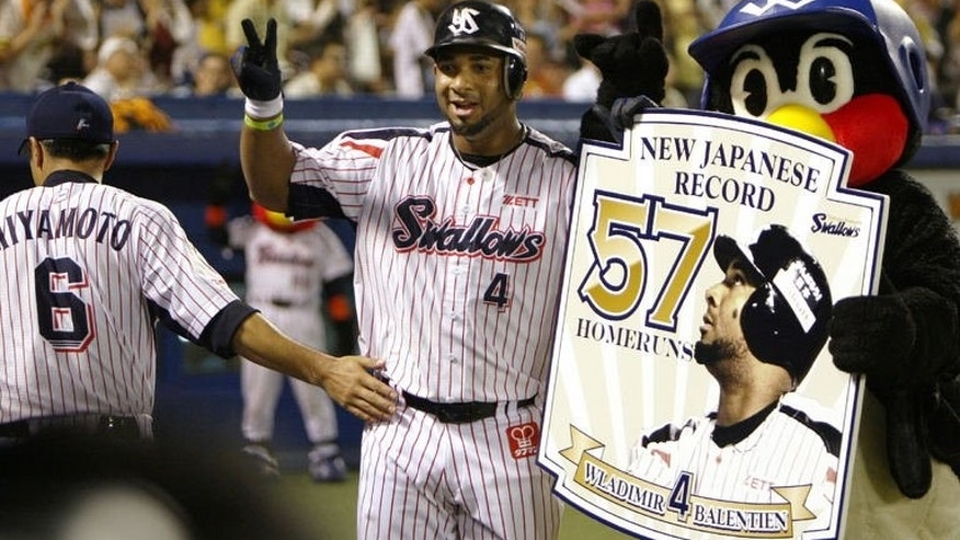 Japan's Yakult Swallows outfielder Wladimir Balentien (centre) of Curacao, Netherlands Antilles, celebrates his 57th home run as the Japanese single-season record during a baseball game against Hanshin Tigers in Tokyo on September 15, 2013. The former US major leaguer slammed his 56th and 57th home runs of the season to break a Japanese league record.