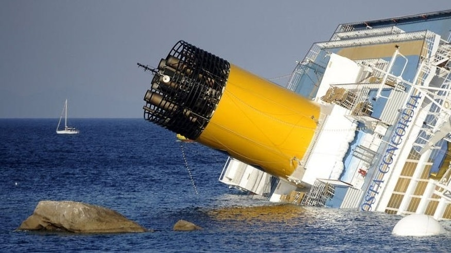 View of the Costa Concordia on January 14, 2012, after the cruise ship ran aground and keeled over off the Italian island of Giglio. Italian officials have given the go-ahead for an unprecedented salvage operation to lift the 114,500-ton Costa Concordia cruise ship from its side on Monday.