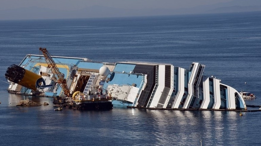 View of the Costa Concordia cruise ship near the harbour on the Italian island of Giglio, off Tuscany on June 23, 2012. The Italian island of Giglio made final preparations Sunday on the eve of an unprecedented attempt to raise the 114,500-ton Costa Concordia cruise ship from its watery grave.