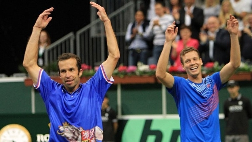 Tomas Berdych (R) and Radek Stepanek of Czech Republic celebrate after defeating Argentina in a Davis Cup semi-final on September 14, 2013 in Prague.