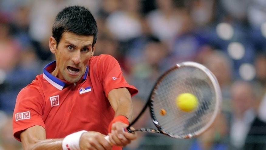 Serbia's Novak Djokovic returns the ball to Canada's Milos Raonic during their Davis Cup match at the Belgrade Arena on September 15, 2013.