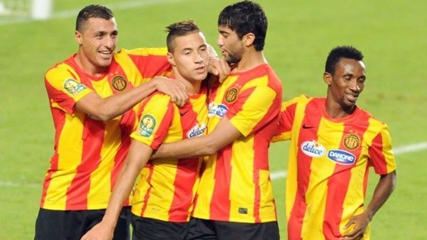 Esperance de Tunis striker Youssef Blaili celebrates with his teammates during their CAF Champions League football Group A match on August 3, 2013 near Tunis. The Tunis team have secured semi-final place in the tournament.
