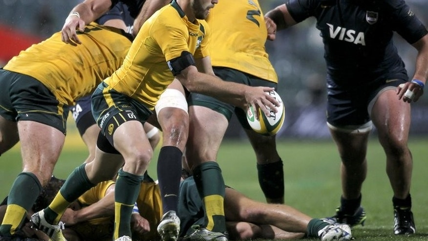 Australia's Nic White (2nd L) clears the ball during their Rugby Championship match against and Argentina at Paterson Stadium in Perth on September 14, 2013.