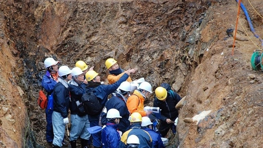 Japan's Nuclear Regulation Authority members inspect a fault zone near the Oi Nuclear Power Plant on December 28, 2012.