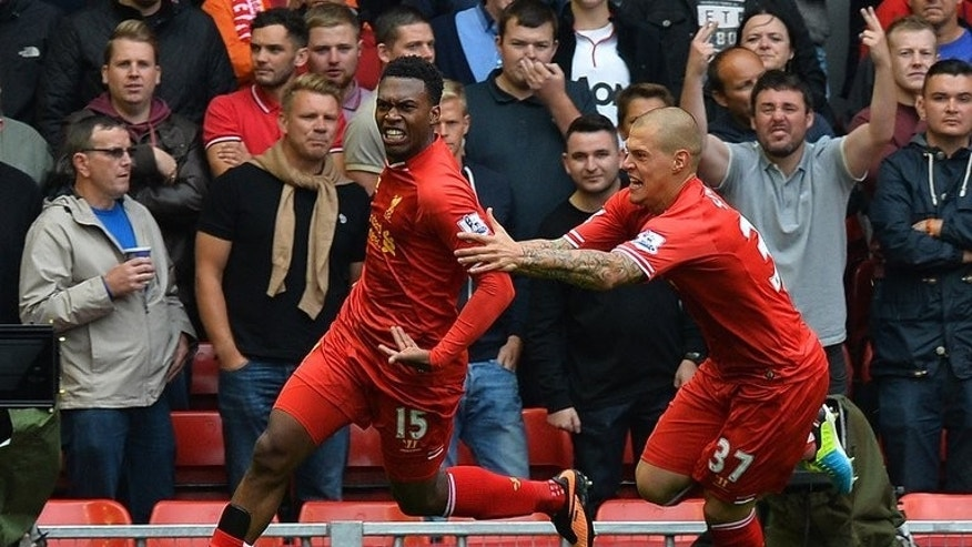 Liverpool striker Daniel Sturridge (L) celebrates with teammate Martin Skrtel after scoring during their Premier League match against Manchester United at Anfield stadium in Liverpool on September 1, 2013.