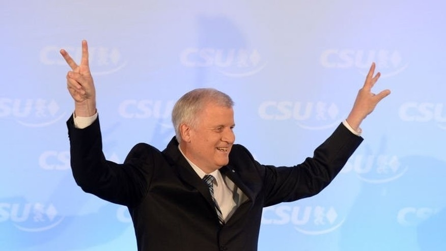 Bavarian State Premier Horst Seehofer of the Christian Social Union (CSU) party delivers a speech after exit polls of regional elections in Bavaria were published on September 15, 2013 in Munich, Germany.