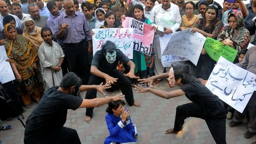 Pakistani workers from NGOs perform during an anti-rape protest in Lahore on September 14, 2013.