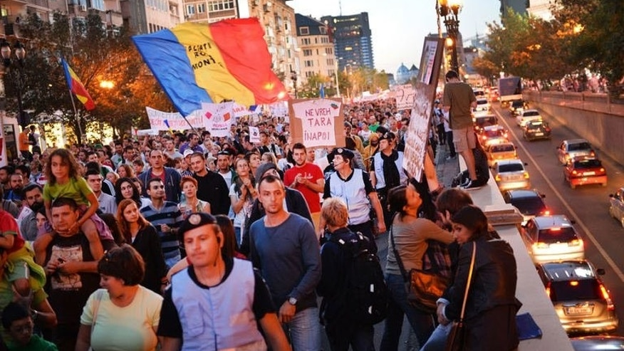 Protesters march for the fifteenth day of demonstrations on September 15, 2013 in Bucharest against Rosia Montana Gold Corporation.