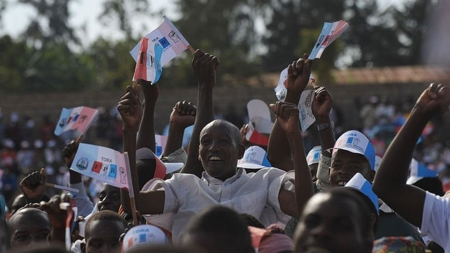 Supporters of the Rwandan President and the ruling Rwandan Patriotic Front (RPF) party attend a campaign rally in the capital Kigali on September 14, 2013, ahead of the country's parliamentary polls.