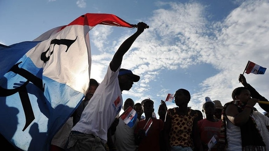A man holds a party flag as supporters of the ruling Rwandan Patriotic Front (RPF) rally in Kigali on September 14, 2013, ahead of the country's parliamentary polls.