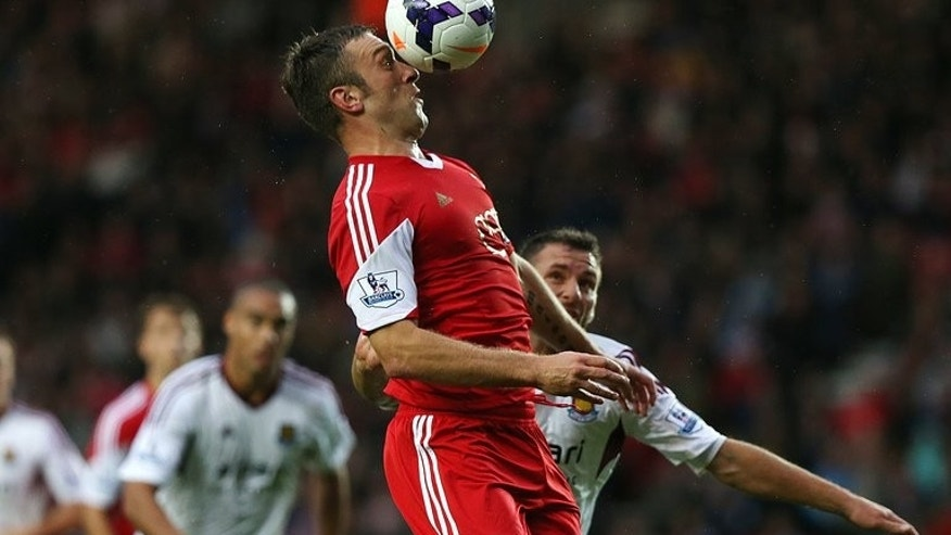 Southampton's English striker Rickie Lambert heads the ball during the English Premier League football match between Southampton and West Ham United at St Mary's Stadium in Southampton, southern England, on September 15, 2013.
