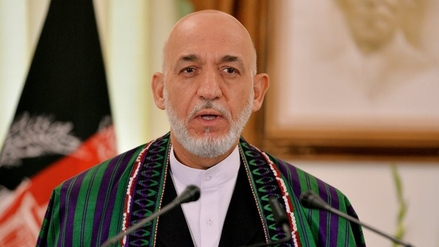 Afghan President Hamid Karzai speaks during a joint press conference in Islamabad on August 26, 2013. Candidates looking to succeed him must register by October 6.