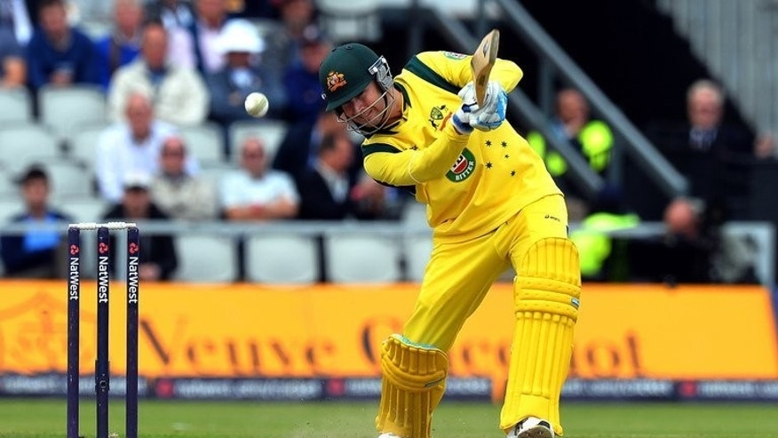 Australia captain Michael Clarke bats in the second one day international (ODI) cricket match against England at Old Trafford in Manchester, on September 8, 2013. Clarke won the toss and elected to bat against England in the fifth and final day/night ODI in Southampton on Monday.