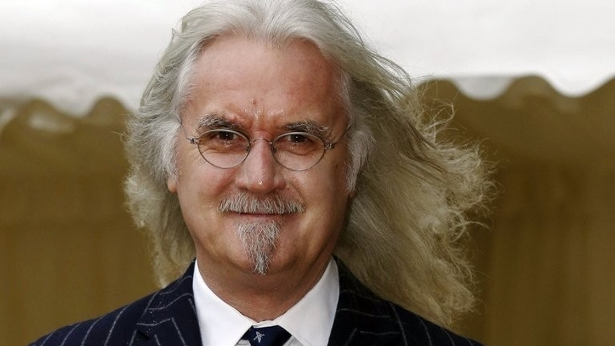 "Scottish comedian and actor Billy Connolly attends a reception celebrating the British Film Industry hosted by Queen Elizabeth and Prince Philip in Windsor Castle in Windsor on April 4, 2013. Connolly has had surgery for prostate cancer and is being treated for the ""initial symptoms"" of Parkinson's Disease, his spokeswoman said Monday."