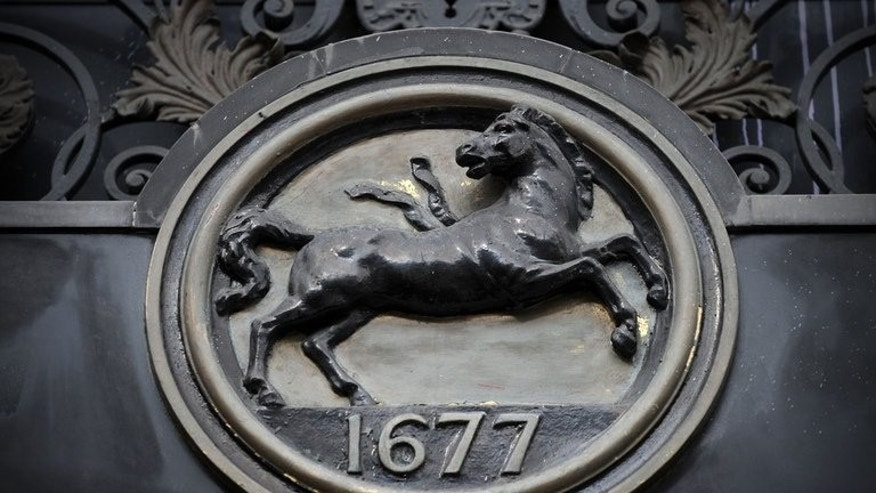 A Lloyds Banking Group logo is pictured outside a branch in central London on October 7, 2011.