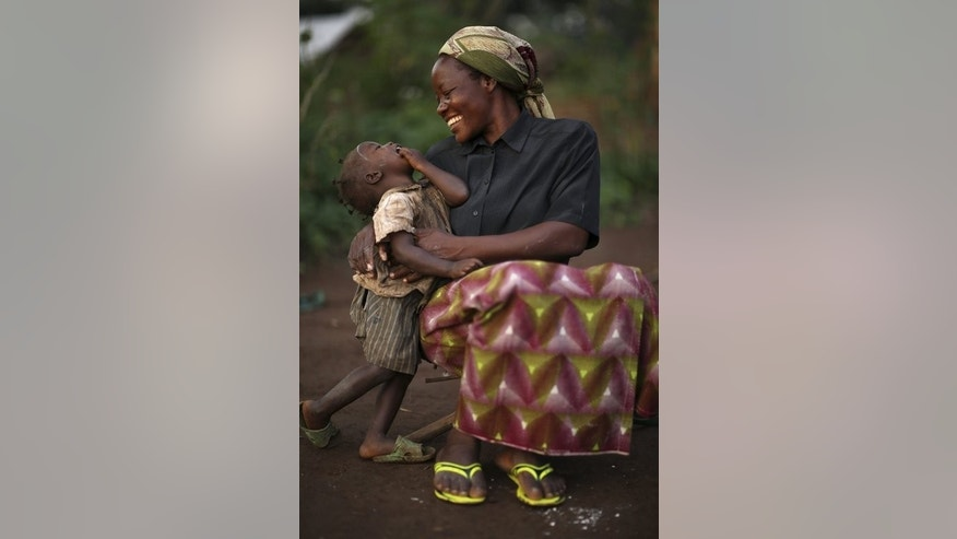 Sister Angelique Namaika embracing a displaced Congolese child in Dungu, DRC, in a picture released September 17, 2013.