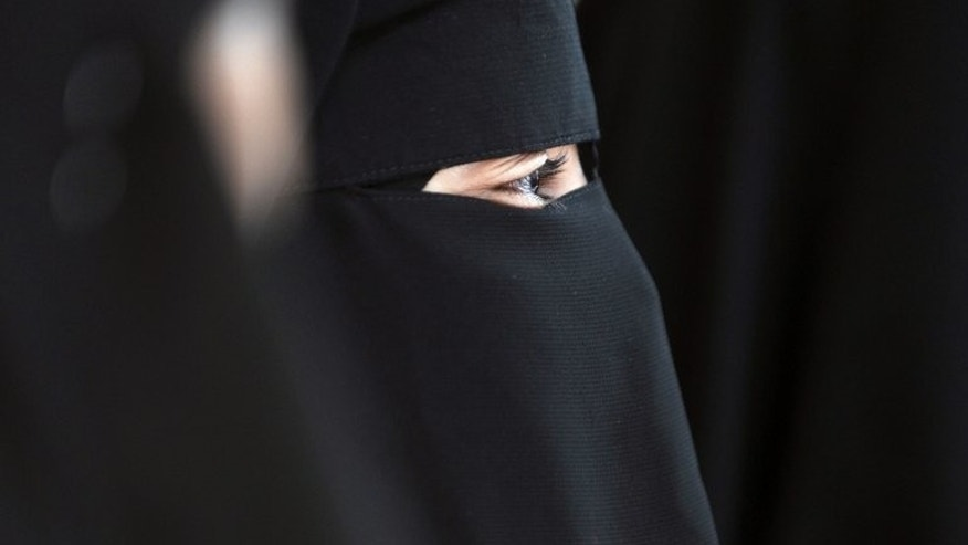 File picture shows a Muslim woman wearing the niqab -- a full-face veil which covers the body and leaves only a small strip for the eyes -- in Montreuil near Paris, on May 18, 2010. A Muslim woman will be allowed to go on trial in Britain wearing a niqab but must take it off while giving evidence, thought to be a legal first, a judge ruled Monday.