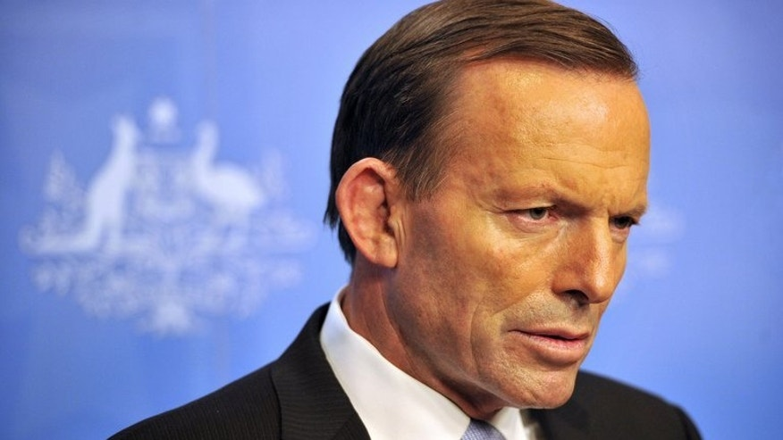 Australia's prime minister-elect Tony Abbott speaks to the media at Parliament House in Canberra, on September 16, 2013. Abbott has said his tougher border protection scheme, with the navy towing asylum-seeker boats back to Indonesia, will begin as soon as his government is sworn in.