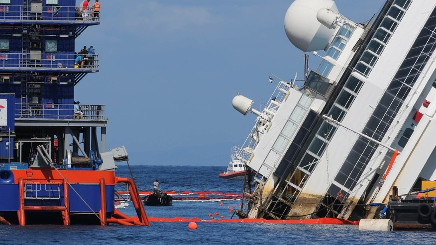 Sept. 16, 2013 - The Costa Concordia ship lies on its side on the Tuscan Island of Giglio, Italy. Engineers succeeded in wresting the hull of the shipwrecked Costa Concordia from the Italian reef where it has been stuck since it capsized in January 2012, leaving them cautiously optimistic they can rotate the luxury liner upright and eventually tow it away. Never before has such an enormous cruise ship been righted, and the crippled Concordia didn't budge for the first three hours after the operation began.