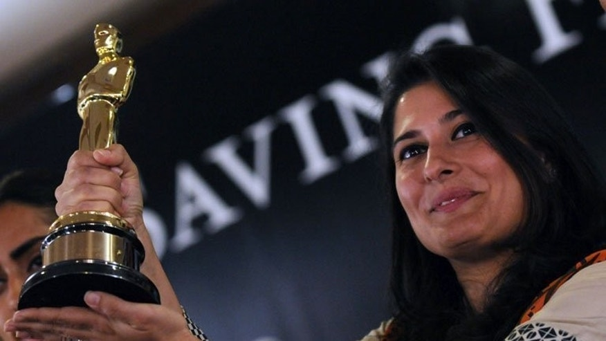 Pakistani director Sharmeen Obaid-Chinoy shows her Best Documentary Short Oscar during a press conference in Karachi on March 10, 2012. In 2012, Obaid-Chinoy became the first Pakistani to claim Hollywood's most coveted gong for co-directing a documentary about victims of acid attacks.